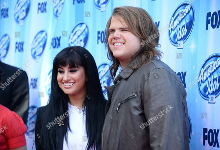 Jena Irene, left, and Caleb Johnson arrive at the American Idol XIII finale at the Nokia Theatre at L.A. Live, in Los Angeles