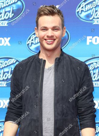 Finalist Clark Beckham arrives at the American Idol XIV finale at the Dolby Theatre, in Los Angeles