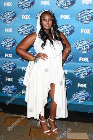 Season 12 winner, Candice Glover, poses in the press room at the American Idol XIV finale at the Dolby Theatre, in Los Angeles