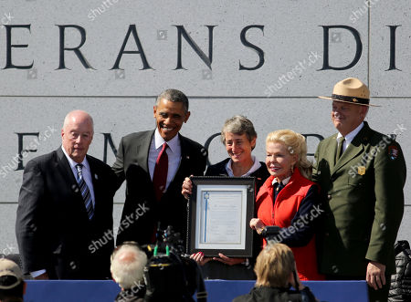 Arthur Wilson, President of DVLMF, left, President Barack Obama, Sally Jewell, Secretary of the Interior, Lois Pope Chairman of the DVLMF and Robert Vogel Superintendent, National Mall and Memorial Parks, attend the dedication ceremony of the American Veterans Disabled for Life Memorial, in Washington DC