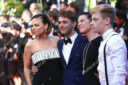 From right, actor Antoine-Olivier Pilon, actress Anne Dorval, director Xavier Dolan and actress Suzanne Clement from the film Mommy arrive for the awards ceremony at the 67th international film festival, Cannes, southern France