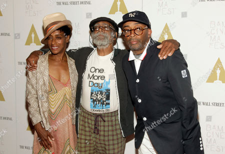 "Director Spike Lee, right, with sister, screenwriter Joie Lee, left and father Bill Lee, center, attends a screening of ""Do The Right Thing"" at BAMcinemaFest 2014, in New York"