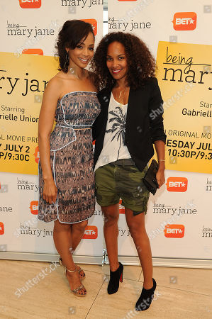 Latarsha Rose (left) and Mara Brock Akil attends the Los Angeles screening of BET's Being Mary Jane at the Paley Center for Media, on in Beverly Hills, California