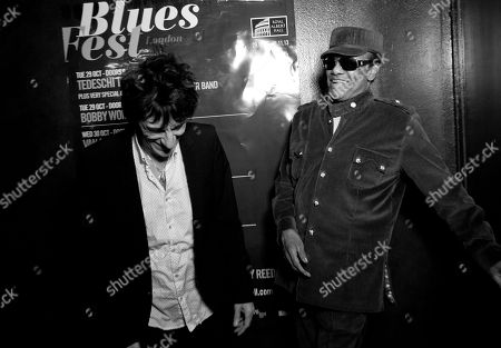 Stock Photo of British musician Ronnie Wood, left, laughs with U.S singer/songwriter Bobby Womack, as the latter is presented with the 'Bluesfest Lifetime Achievement Award' for Services To Soul', at the Royal Albert Hall in west London
