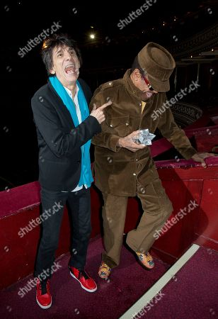 British musician Ronnie Wood, left, laughs with U.S singer/songwriter Bobby Womack, as the latter is presented with the 'Bluesfest Lifetime Achievement Award' for Services To Soul', at the Royal Albert Hall in west London