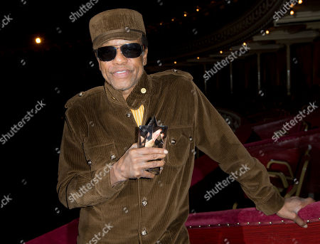 Stock Picture of U.S singer/songwriter Bobby Womack poses for photographs after he is presented with the 'Bluesfest Lifetime Achievement Award' for Services To Soul', at the Royal Albert Hall in west London