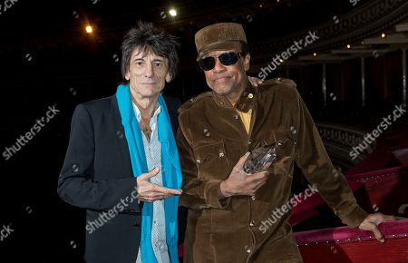 British musician Ronnie Wood, left, presents U.S singer/songwriter Bobby Womack with the 'Bluesfest Lifetime Achievement Award' for Services To Soul', at the Royal Albert Hall in west London
