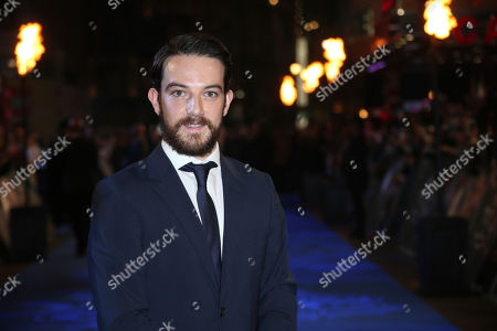 Actor Kevin Guthrie poses for photographers upon arrival at the premiere of the film 'Fantastic Beasts And Where To Find Them' in London