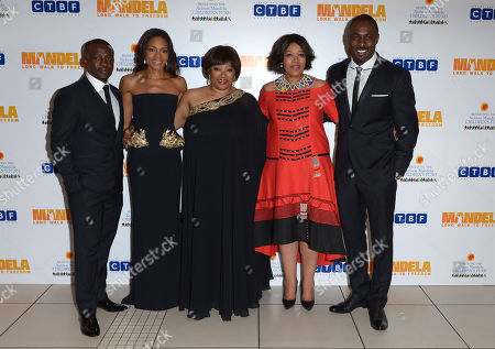 Stock Picture of From left to right, Tony Kgoroge, Naomie Harris, Zindzi Mandela, her sister Zenani, and Idris Elba pose for photographers at the UK Premiere of 'Mandela: Long Walk To Freedom' at the Odeon Leicester Square in London on