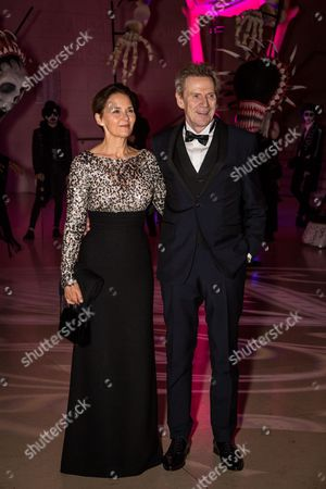 Stock Picture of Tove Bornhoeft and Jesper Christensen pose for photographers upon arrival at the James Bond Spectre party in London