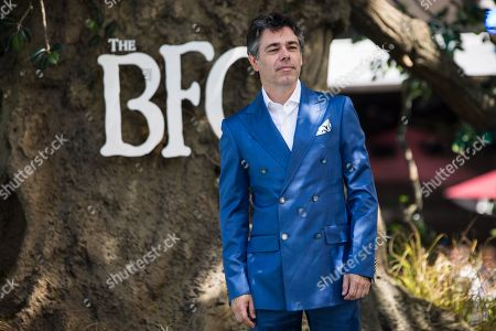 Jonathan Holmes poses for photographers upon arrival at the premiere of the film 'The BFG' in London