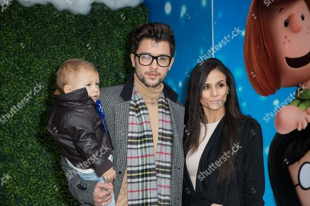 """JJ Hamblett, Caterina Lopez and their son Princeton pose for photographers upon arrival at the gala screening of """"Snoopy and Charlie Brown: The Peanuts Movie"""" in London"""