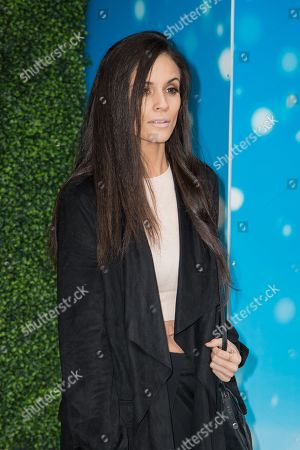 """Caterina Lopez poses for photographers upon arrival at the gala screening of """"Snoopy and Charlie Brown: The Peanuts Movie"""" in London"""