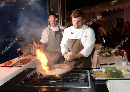 Chefs Ben Ford, right, and Graham Elliot participate in the Chase Sapphire Preferred Chef Challenge during the Ultimate Bites of L.A. at the Los Angeles Food & Wine Festival, presented by FOOD & WINE, on in Los Angeles