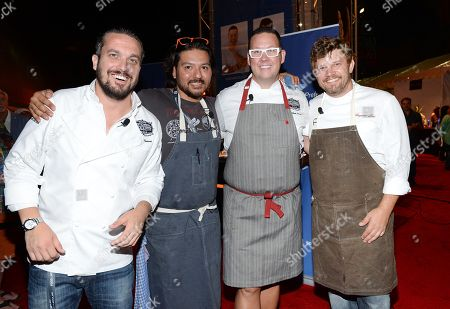 Chefs Fabio Viviani, left, Ray Garcia, Graham Elliot and Ben Ford participate in the Chase Sapphire Preferred Chef Challenge during the Ultimate Bites of L.A. at the Los Angeles Food & Wine Festival, presented by FOOD & WINE, on in Los Angeles