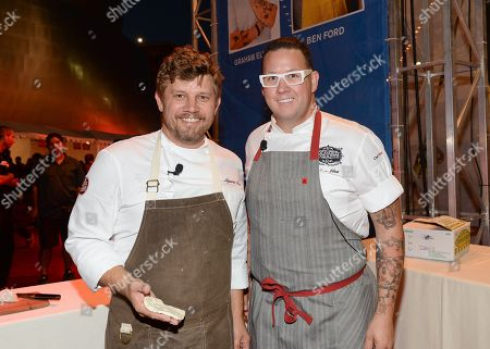 Chefs Ben Ford, left, and Graham Elliot participate in the Chase Sapphire Preferred Chef Challenge during the Ultimate Bites of L.A. at the Los Angeles Food & Wine Festival, presented by FOOD & WINE, on in Los Angeles