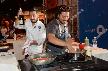 Chefs Fabio Viviani, left, and Ray Garcia participate in the Chase Sapphire Preferred Chef Challenge during the Ultimate Bites of L.A. at the Los Angeles Food & Wine Festival, presented by FOOD & WINE, on in Los Angeles