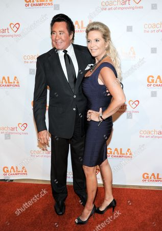 Wayne Newton, left, and Kathleen McCrone arrive at the CoachArt 2013 Gala of Champions at the Beverly Hilton Hotel on in Beverly Hills, Calif