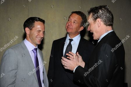 Bryan Cranston, right, Jeremy Zimmer, center, and Zander Lurie attendt the CoachArt 2013 Gala of Champions at the Beverly Hilton Hotel on in Beverly Hills, Calif