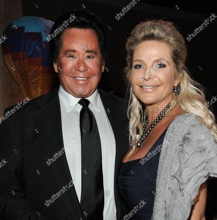 Wayne Newton, left, and Kathleen McCrone attend the CoachArt 2013 Gala of Champions at the Beverly Hilton Hotel on in Beverly Hills, Calif