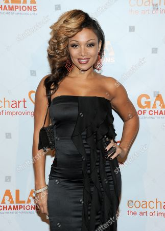 Chante Moore arrives at the CoachArt 2013 Gala of Champions at the Beverly Hilton Hotel on in Beverly Hills, Calif