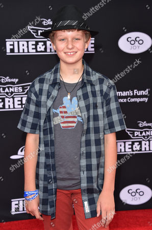 Stock Photo of Riley Thomas Stewart arrives at the premiere of Disney's Planes: Fire & Rescue sponsored by Coco Joy Kids at El Capitan, in Los Angeles