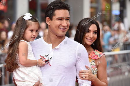 Mario Lopez, center, and from left, Gia Francesca Lopez and Courtney Laine Mazza arrive at the premiere of Disney's Planes: Fire & Rescue sponsored by Coco Joy Kids at El Capitan, in Los Angeles