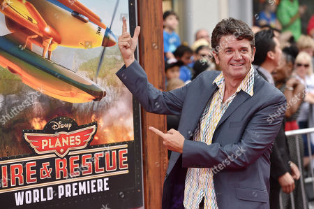 John Michael Higgins arrives at the premiere of Disney's Planes: Fire & Rescue sponsored by Coco Joy Kids at El Capitan, in Los Angeles