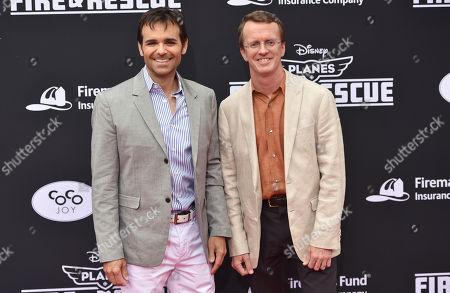 Producer Ferrell Barron, left, and director Roberts Gannaway arrive at the premiere of Disney's Planes: Fire & Rescue sponsored by Coco Joy Kids at El Capitan, in Los Angeles
