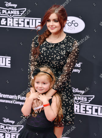 Ariel Winter and guest arrive at the premiere of Disneyâ?™s Planes: Fire & Rescue sponsored by Coco Joy Kids at El Capitan, in Los Angeles