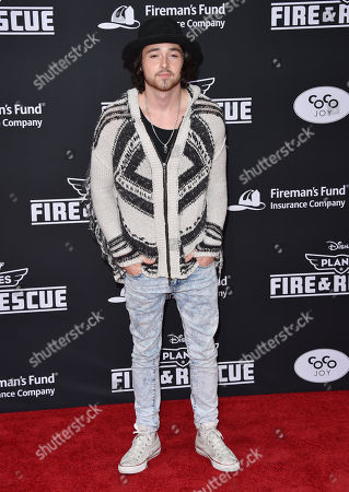 Spencer Lee arrives at the premiere of Disneyâ?™s Planes: Fire & Rescue sponsored by Coco Joy Kids at El Capitan, in Los Angeles