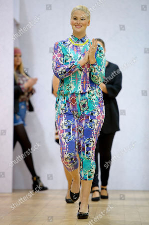 Model Whitney Thompson wears a design during the Plus Size Fashion event during London Fashion Week Autumn/Winter 2014, at Vinopolis in central London