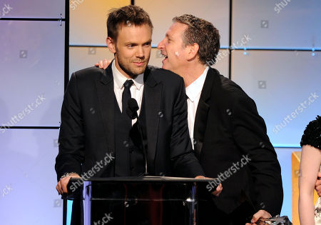 """Joel McHale, left, and Russ Krasnoff accept the award for best comedy for """"Community"""" onstage at the 2nd Annual Critics' Choice Television Awards at the Beverly Hilton Hotel on in Beverly Hills, Calif"""