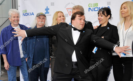 Stock Picture of Emcee Jack Black, front, mugs with fellow participants in Light Up The Blues Concert - An Evening of Music Benefitting Autism Speaks, at Club Nokia on in Los Angeles. Left to right behind Black are musicians Graham Nash adn David Crosby, Kathryn Nicholson, Don Felder, Black's wife Tanya Haden and co-host Kristen Stills