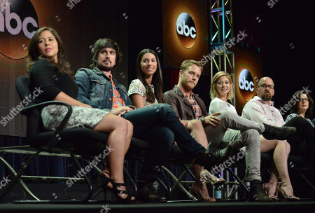 From left, Chloe Wepper, Nicolas Wright, Jade Catta-Preta, Jake McDorman, Analeigh Tipton, Creator/executive producer Jeff Lowell and Executive producer Robin Schwartz speak on stage during the 'Manhattan Love Story'' panel at the Disney/ABC Television Group 2014 Summer TCA at the Beverly Hilton Hotel, in Beverly Hills, Calif