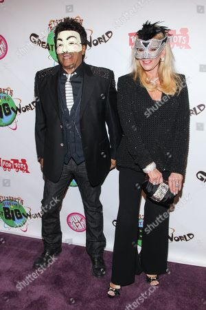 Actor Erik Estrada (L) and TV personality Laura McKenzie arrive at Elizabeth Stanton's 18th birthday benefiting Toys for Tots at Belasco Theatre on in Los Angeles