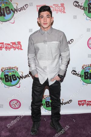 Singer Al Calderon arrives at Elizabeth Stanton's 18th birthday benefiting Toys for Tots at Belasco Theatre on in Los Angeles