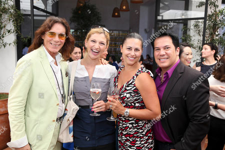 Stock Picture of From left, George Blodwell, Celebrity Stylist; Olena Sholomytska, Thursday Friday; Annissa Gloss, FGILA and Charlie Lapson, Stylist pose at Fashion Group International of Los Angeles luncheon to present a fashion scholarship fund honoring Ilse Metchek and the California Fashion Association held at Fig & Olive, in Los Angeles, Calif