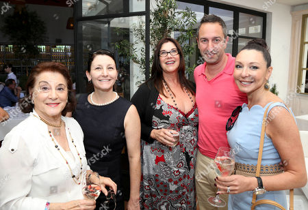 From left, Ilse Metchek, California Fashion Association; Alison A. Nieder, California Apparel News; Linda Arroa, FGILA; Christos Garkinos, Decades and Galina Sobolov pose at Fashion Group International of Los Angeles luncheon to present a fashion scholarship fund honoring Ilse Metchek and the California Fashion Association held at Fig & Olive, in Los Angeles, Calif