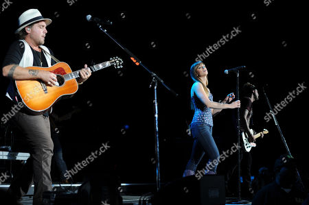 Tom Gossin,Rachel Reinert and Mike Gossin of Gloriana perform during the Rewind Tour at the Cruzan Amphitheater on in West Palm Beach, Florida