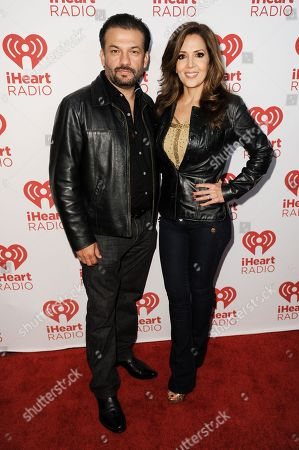 David Barrera, left, and Maria Canals-Barrera arrive at the iHeartRadio Fiesta Latina Concert, in Inglewood, Calif