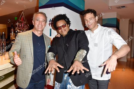 Ricky Arreola, from left, ELEW, and Rocco DiSpirito attend the InspIRIE Dinner Gala at the Sherborne Wyndham Grand South Beach, in Miami Beach, Fla