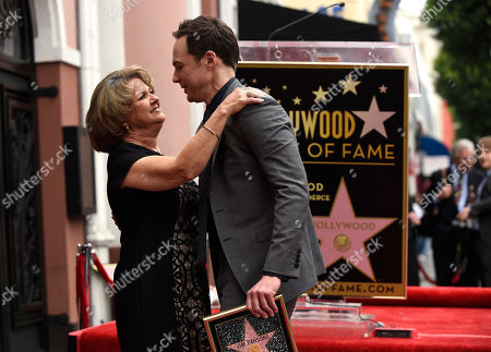 Stock Image of Jim Parsons, right, with his mother Judy Parsons, is honored with a star at the Hollywood Walk of Fame, in Los Angeles
