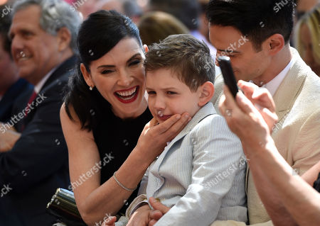 Stock Image of Julianna Margulies, left, and son Kieran Lieberthal, are seen at a ceremony where she is honored with the 2,550th star on the Hollywood Walk of Fame at Hollywood Boulevard, in Los Angeles