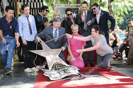 Simon Helberg, Kunal Nayar, Melissa Rauch, Kaley Cuoco, Johnny Galecki, Jim Parsons, and Chuck Lorre attend the ceremony honoring Kaley Cuoco With A Star On The Hollywood Walk Of Fame, in Los Angeles