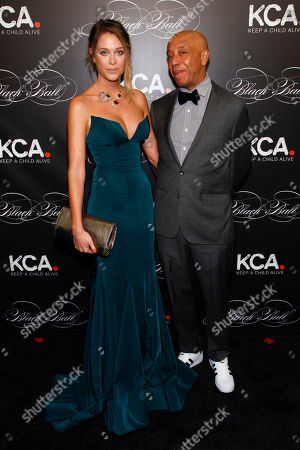 Genevieve Barker, left, and Russell Simmons, right, attend Keep a Child Alive's 13th Annual Black Ball at the Hammerstein Ballroom, in New York