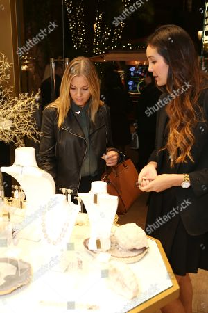 From left, Lizzy Worrall looks at jewelry with Courtney Wellington during the Luxe Party at the Kendra Scott Fashion Island Boutique, in Newport Beach, Calif