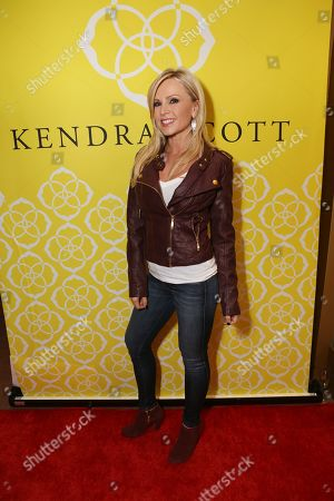 Tamra Barney, from Real Housewives of Orange County, poses during the Luxe Party at the Kendra Scott Fashion Island Boutique, in Newport Beach, Calif
