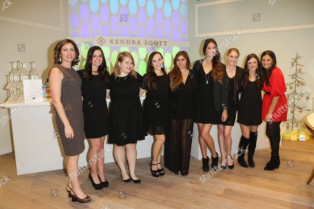 The Kendra Scott boutique staff pose during the Luxe Party at the Kendra Scott Fashion Island Boutique, in Newport Beach, Calif