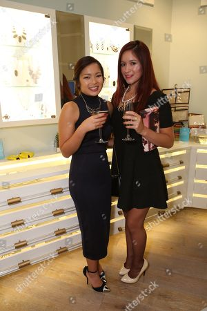 From left, Stacy Ikeda and Emily Centeno pose during the Luxe Party at the Kendra Scott Fashion Island Boutique, in Newport Beach, Calif